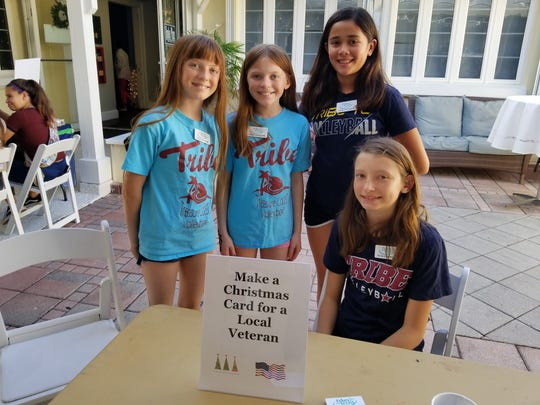 Emma Gorski, Jenna Gorski, Jasmine Fortson and Kiersten Fischer of Tribe TC Volleyball volunteering at the Festival of Trees & Lights
