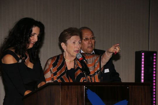 Michelle Miller, Jane Rawley and Thom Jones, during the auction.