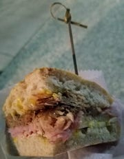 Castaways Gastropub's Don Cubano sandwich boasted generous portions of sliced ham, roasted pork, pork belly, pickles, Swiss cheese and house-made spicy yellow mustard at this year's Taste of Jensen on Tuesday, Dec. 11, 2018.