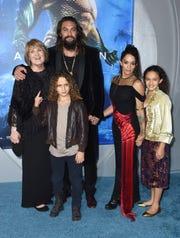 "Coni Momoa, from left, Nakoa-Wolf Manakauapo Namakaeha Momoa, Jason Momoa, Lisa Bonet, and Lola Iolani Momoa arrive at the premiere of ""Aquaman"" at TCL Chinese Theatre on Wednesday, Dec. 12, 2018, in Los Angeles."