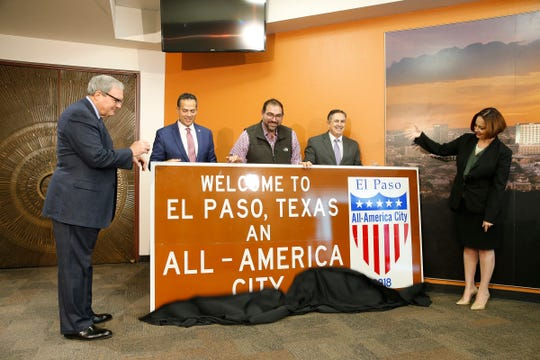 El Paso Mayor Dee Margo, from left, City Manager Tommy Gonzalez, District 1 city Rep. Peter Svarzbein, Deputy City Manager Ted Marquez and Community and Human Development Department Director Nicole Ferrini stand by one of the signs that the city of El Paso unveiled Thursday morning. The new signs will be installed at five entrances into El Paso as a way for the city to boost community pride, promote El Paso's achievements and encourage motorists traveling through the region to stop and explore one of the nation's All-America cities.