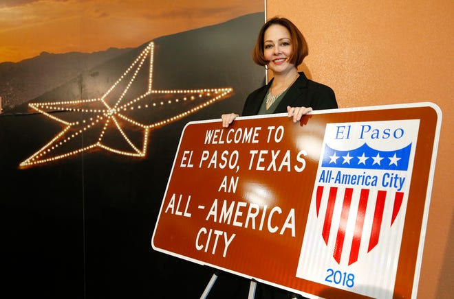 Nicole Ferrini, Community and Human Development Department director, stands by one of the signs that the city of El Paso unveiled in 2018. The signs were installed at five entrances into El Paso as a way for the city to boost community pride, promote El Paso's achievements and encourage motorists traveling through the region to stop and explore one of the nation's All-America cities.
