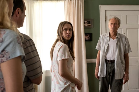 "Taissa Farmiga, center, and Clint Eastwood star in a scene from ""The Mule."""