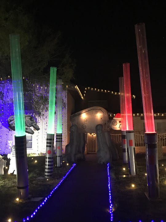 "A home in the Eastridge neighborhood pays tribute to the popular ""Star Wars"" movies, complete with giant light sabers."