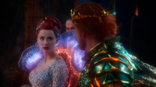 "This image released by Warner Bros. Pictures shows Amber Heard, left and Dolph Lundgren in a scene from ""Aquaman."""