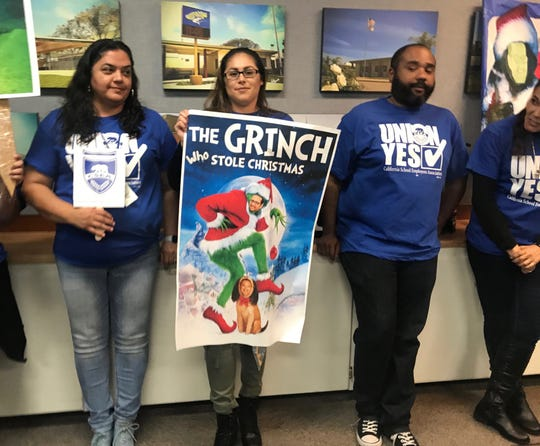 Dozens of people stood and sat inside and outside the boardroom at the Oxnard School District Wednesday to fight a vote to fire 141 campus assistants.