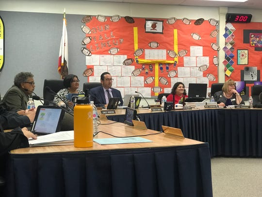 The Oxnard School District board voted 3-2 to grandfather in current campus assistants instead of firing them and forcing them to reapply for new campus supervisor positions.