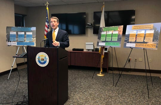 California Insurance Commissioner Dave Jones talk about the costs of recent wildfires during a news conference Wednesday in Sacramento. Insurance claims from last month's California wildfires already are at $9 billion and expected to increase.