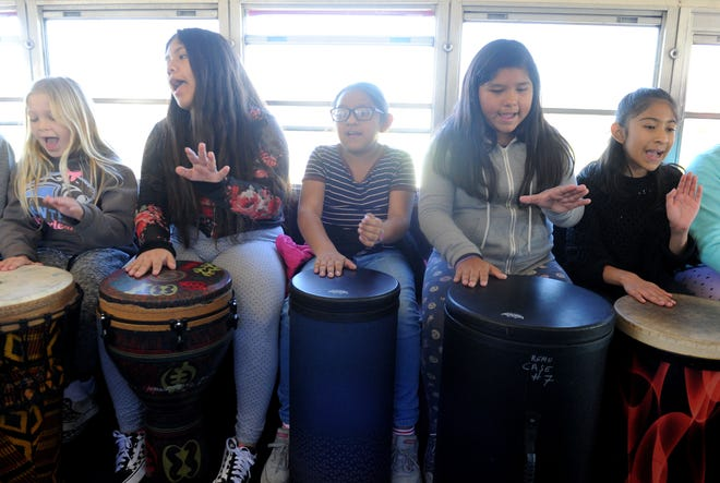 A group of fourth- and fifth-grade students participate in a drumming class as part of the Beat the Odds program at Harrington School in Oxnard.