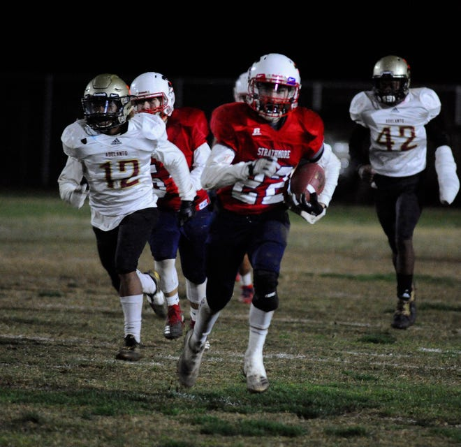 Strathmore's Alonso Acevedo (22) breaks a run against Adelanto during a CIF SoCal Regional Championship Bowl Game on November 30, 2018 at Strathmore High School.