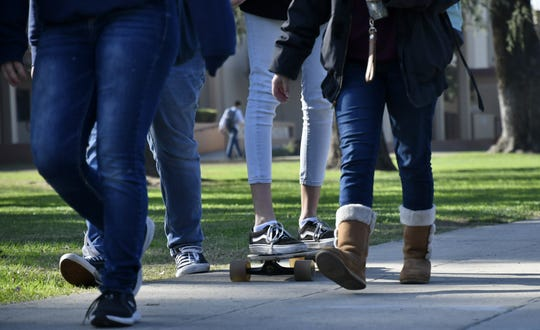 Redwood High School students walk to lunch on Thursday, December 13, 2018.