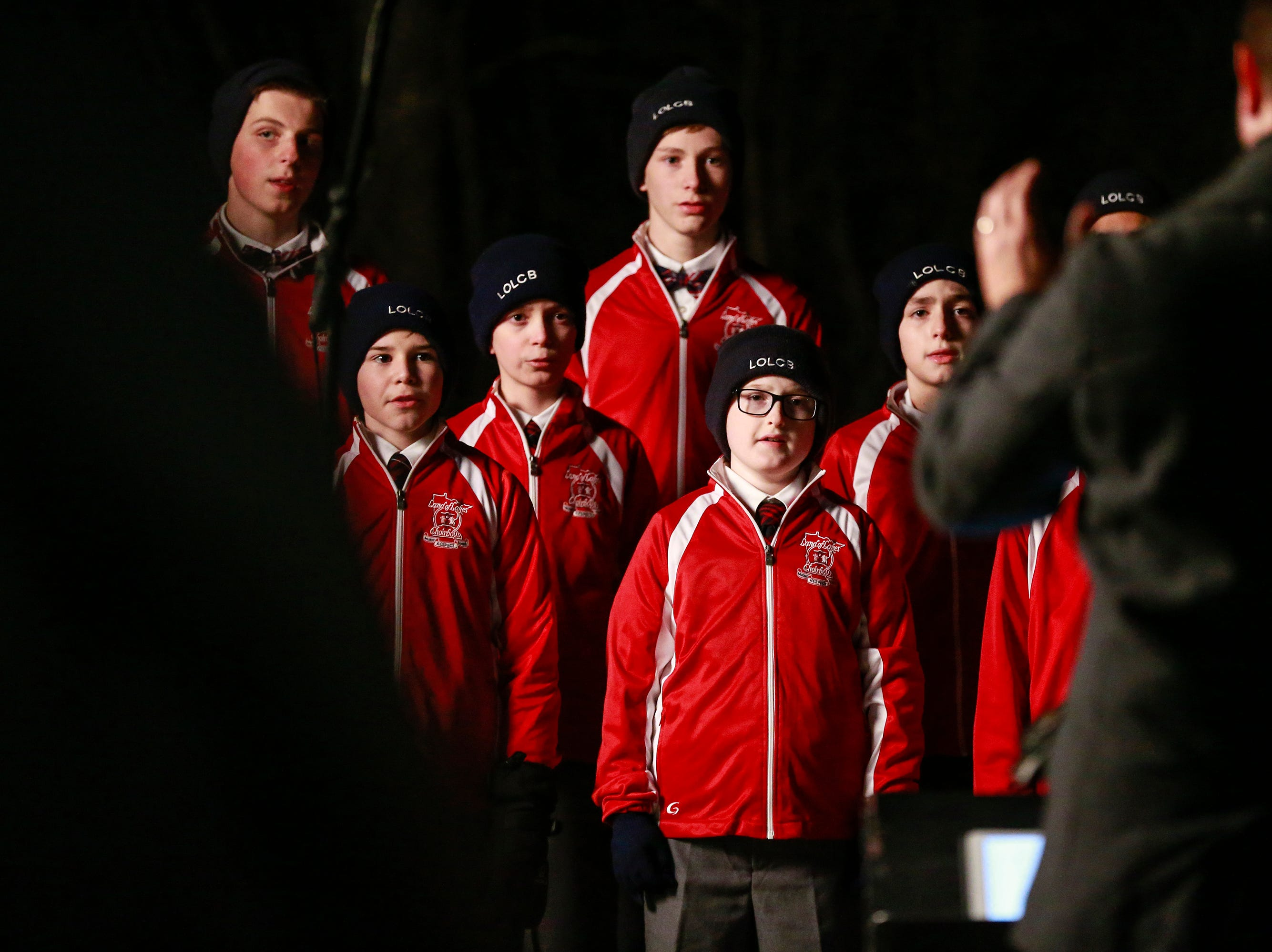 The Lakes Choir Boys performs during the Tree of Hope for Jayme Closs ceremony Wednesday, Dec. 12, 2018, outside of Riverview Middle School in Barron, Wisc. T'xer Zhon Kha/USA TODAY NETWORK-Wisconsin