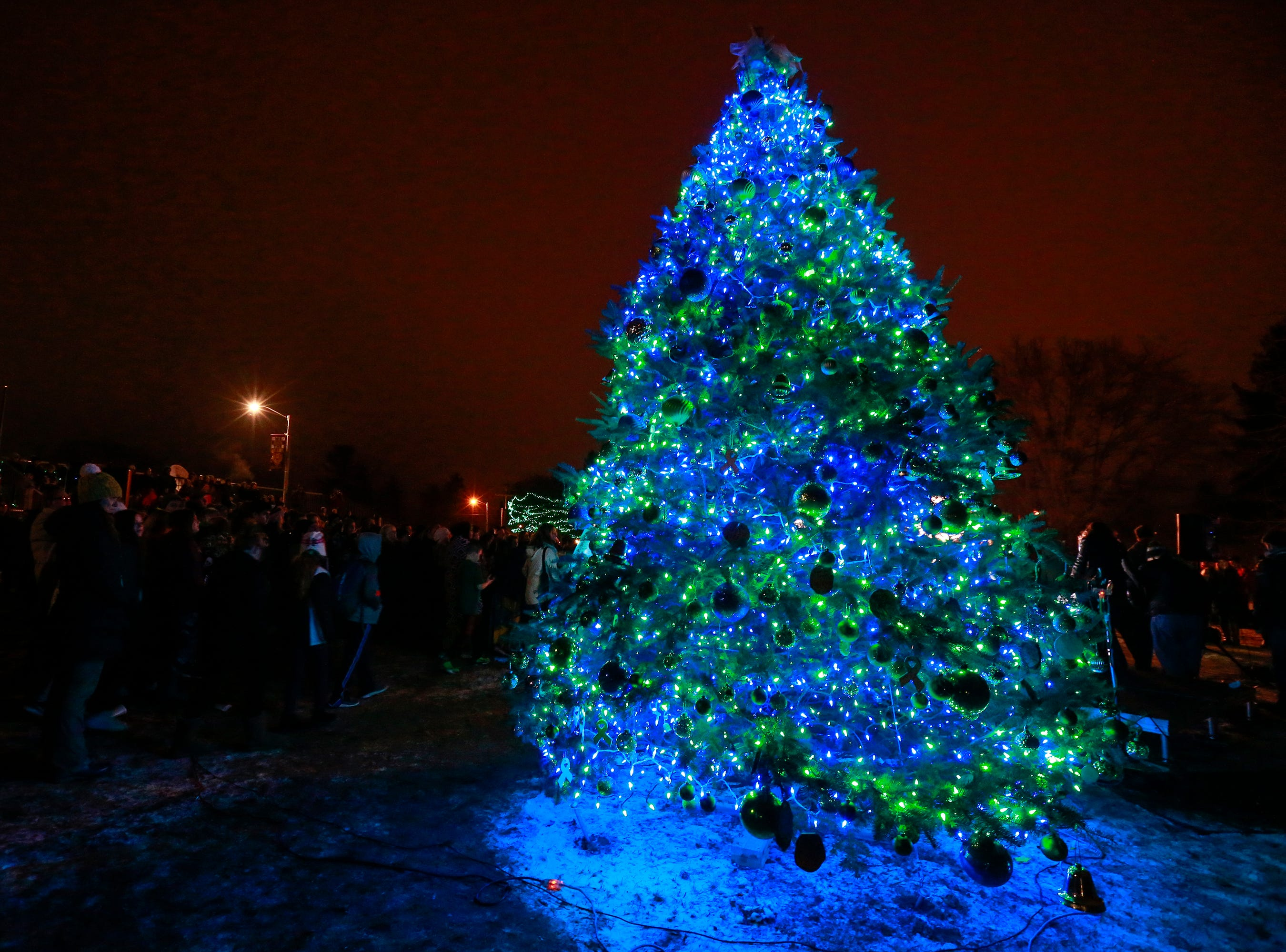The Christmas tree gets lit up as a ceremony of Hope for Jayme Closs Wednesday, Dec. 12, 2018, outside of Riverview Middle School in Barron, Wisc. T'xer Zhon Kha/USA TODAY NETWORK-Wisconsin