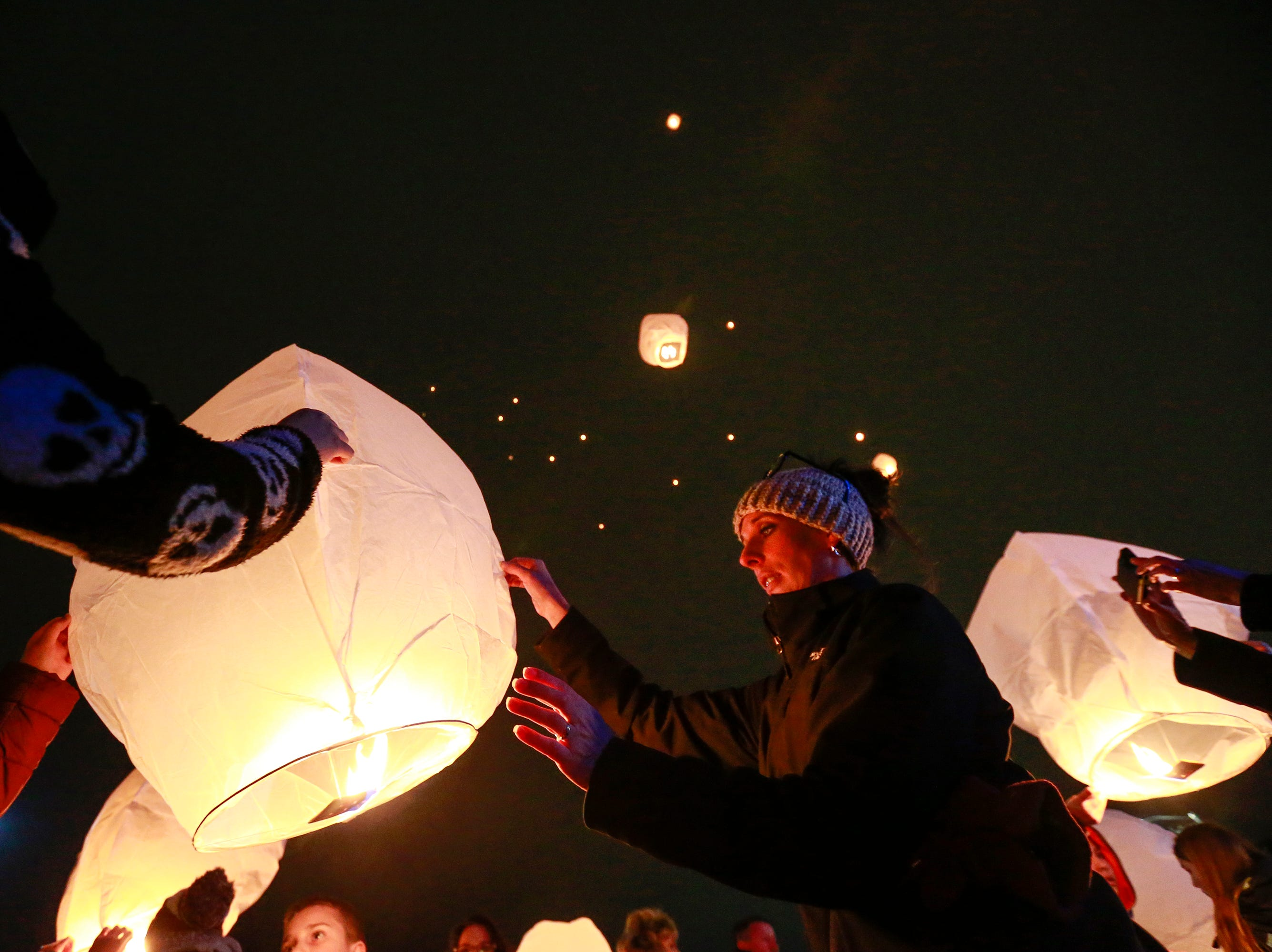 People release lanterns during the Tree of Hope for Jayme Closs ceremony Wednesday, Dec. 12, 2018, outside of Riverview Middle School in Barron, Wisc. T'xer Zhon Kha/USA TODAY NETWORK-Wisconsin