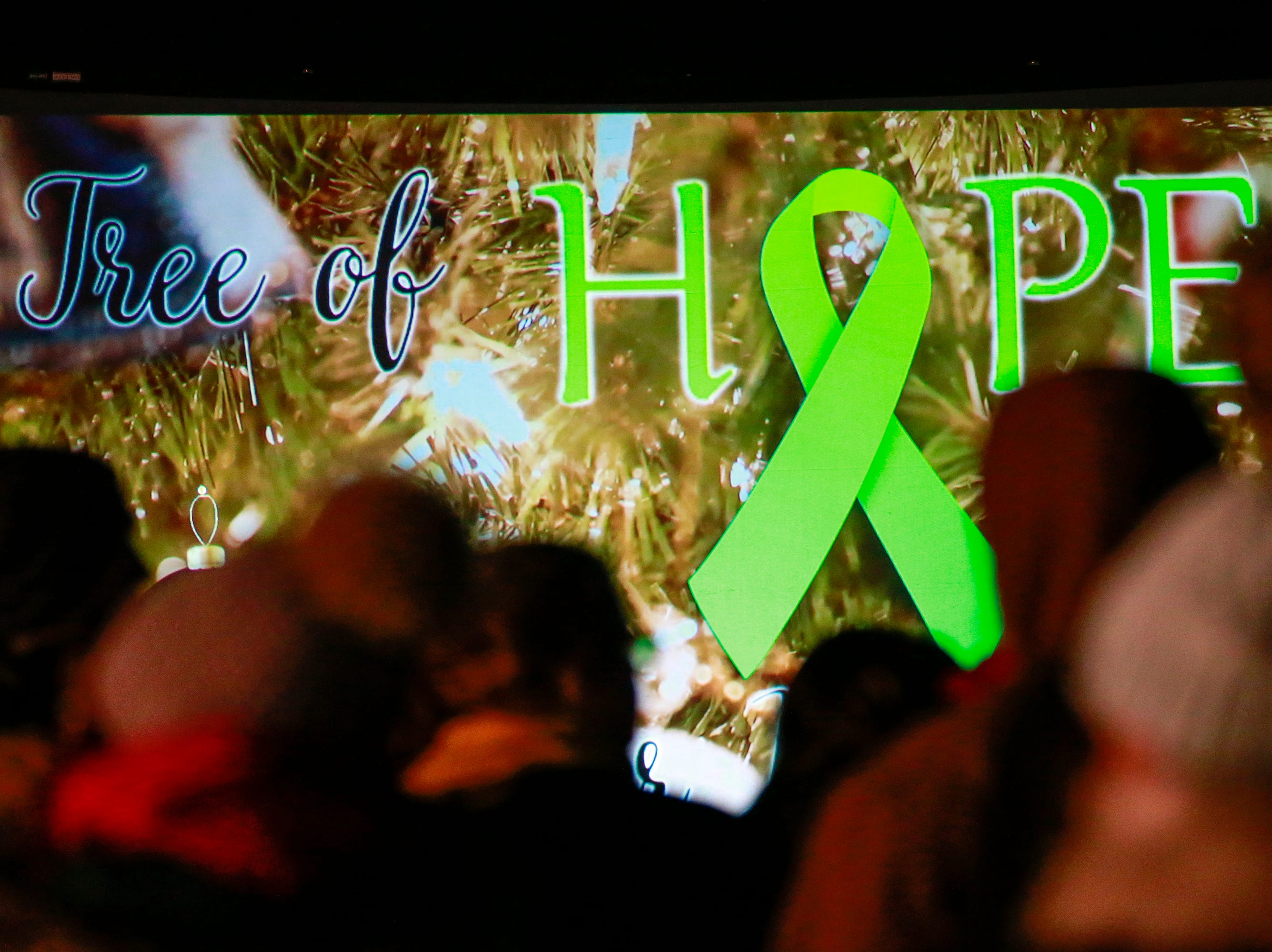 """A projector screen shows a message """"Tree of Hope"""" during the Tree of Hope for Jayme Closs ceremony Wednesday, Dec. 12, 2018, outside of Riverview Middle School in Barron, Wisc. T'xer Zhon Kha/USA TODAY NETWORK-Wisconsin"""