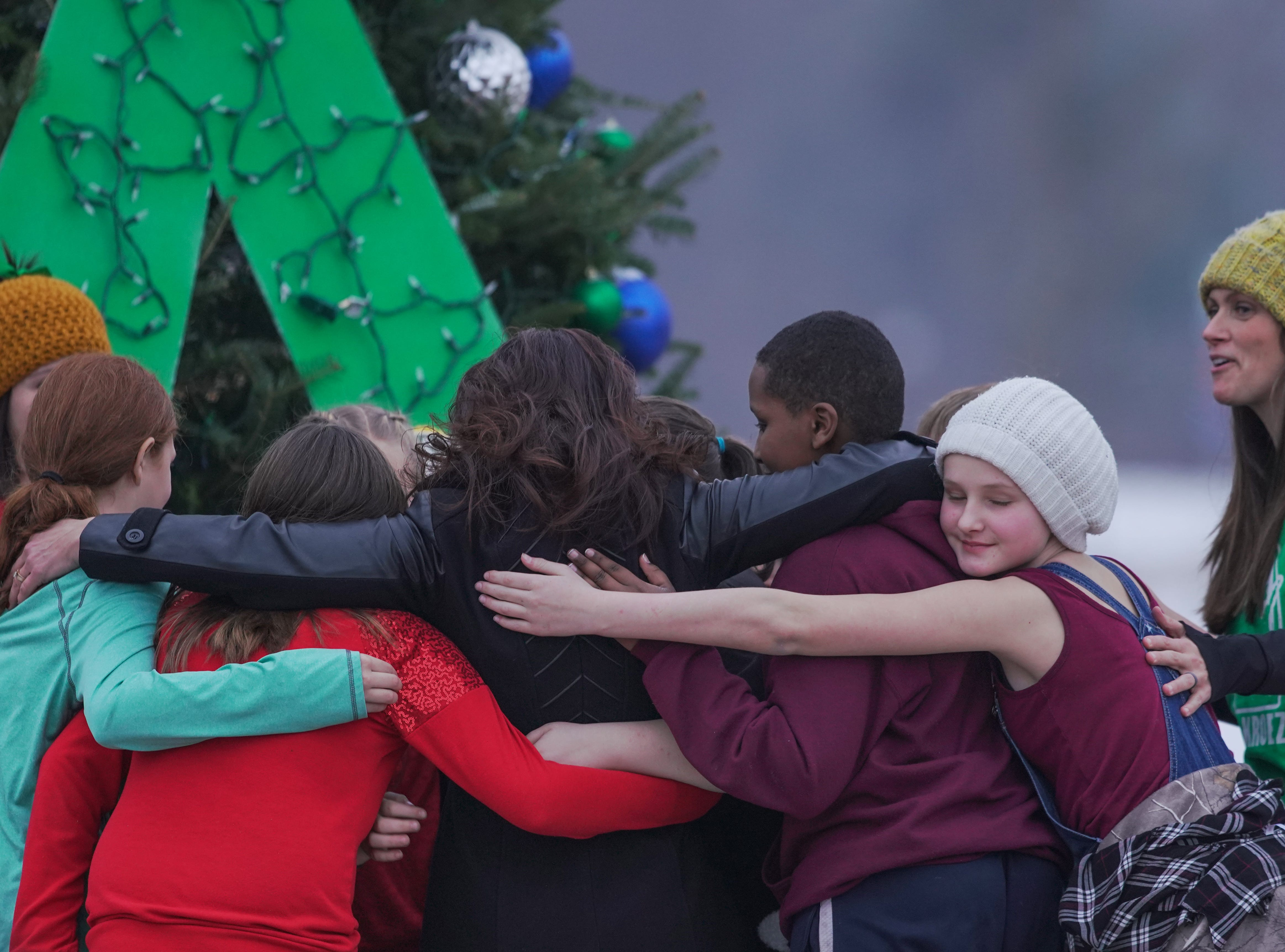 Students embrace with Superintendent Diane Tremblay by the Tree of Hope for Jayme Closs Wednesday, Dec. 12, 2018, outside of Riverview Middle School in Barron, Wisc. T'xer Zhon Kha/USA TODAY NETWORK-Wisconsin