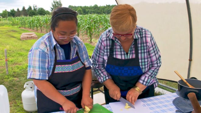 "Latricia Thao works with chef Lidia Bastianich in preparing a traditional Hmong meal, which will be included in a PBS show called ""Lidia Celebrates America: A Heartland Holiday Feast."""