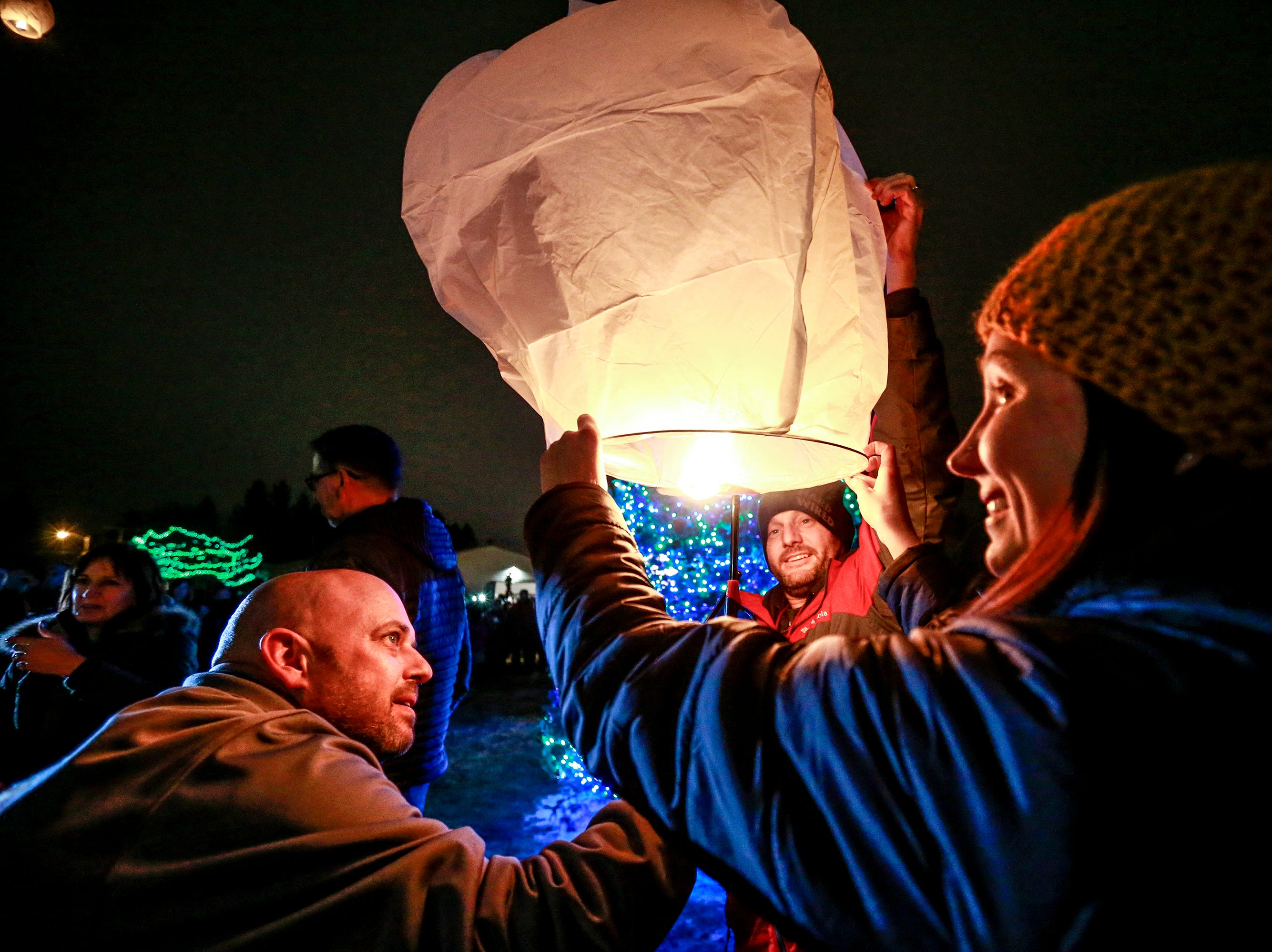 Participants light up lantern to release during the Tree of Hope for Jayme Closs ceremony Wednesday, Dec. 12, 2018, outside of Riverview Middle School in Barron, Wisc. T'xer Zhon Kha/USA TODAY NETWORK-Wisconsin