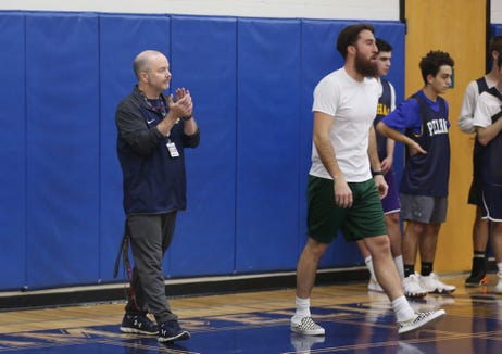 From right, Pelham basketball coach Mark Courtien and assistant coach Mark Finegan run a drill during practice at Pelham High School Dec. 12, 2018. Finegan used to be the Pelham head coach, and Courtien was one of his players.