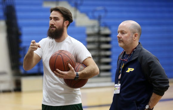 From left, Pelham basketball coach Mark Courtien and assistant coach Mark Finegan run a drill during practice at Pelham High School Dec. 12, 2018. Finegan used to be the Pelham head coach, and Courtier was one of his players.