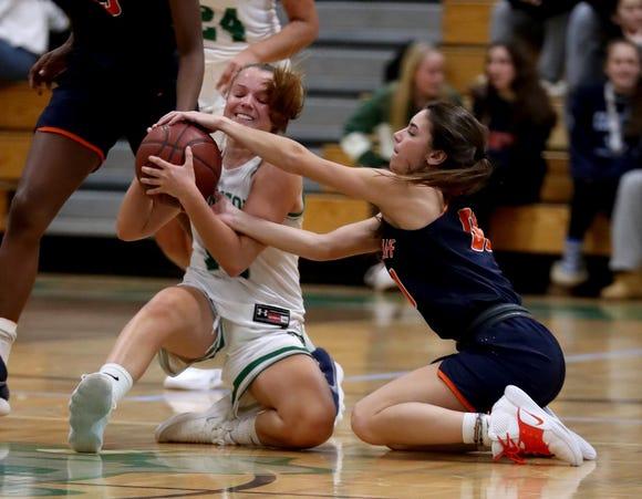 Miranda Farman of Irvingont and Kacey Hamlin of Briarcliff battle for the loose ball during a varsity basketball game at Irvington High School Dec. 12, 2018. Briarcliff defeated Irvington 52-43.