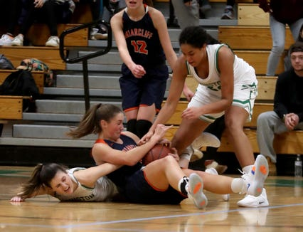 Mia Mascone and Grace Thybulle of Irvington battle Kelly O'Donnell of Briarcliff for a loose ball during a varsity basketball game at Irvington High School Dec. 12, 2018. Briarcliff defeated Irvington 52-43.
