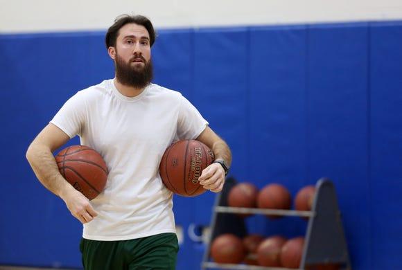 Pelham basketball coach Mark Mark Courtien runs a drill during practice at Pelham High School Dec. 12, 2018.