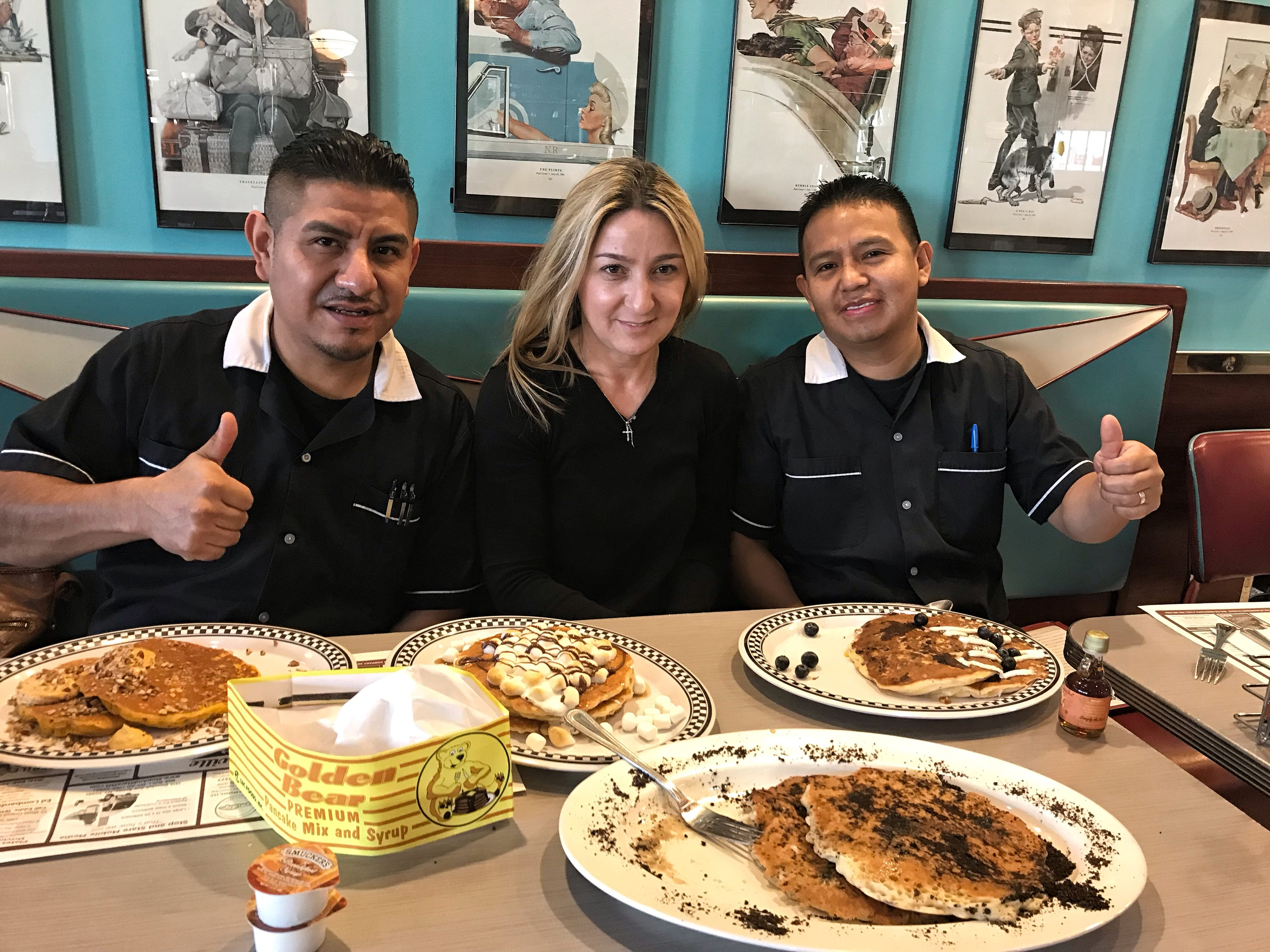 Left to right: Hugo Mata, Bronxville Diner owner Yiota Koriniotu and Otto Jimenez with some of the restaurant's popular pancakes. Photographed Dec. 12, 2018.