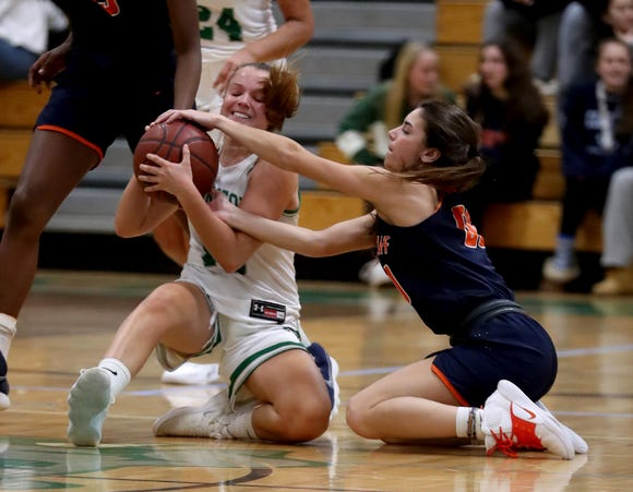 Miranda Farman of Irvingont and Kacey Hamlin of Briarcliff battle for the loose ball during a varsity basketball game at Irvington High School Dec. 12, 2018. Briarcliff defeated Irvington 52-43.