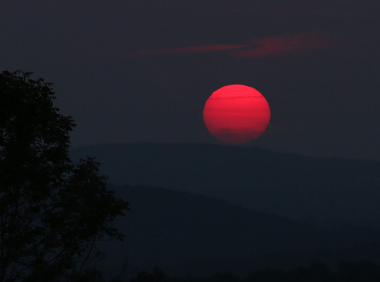 The sun sets after a hot and hazy summer afternoon in Brewster Aug. 15,  2018.