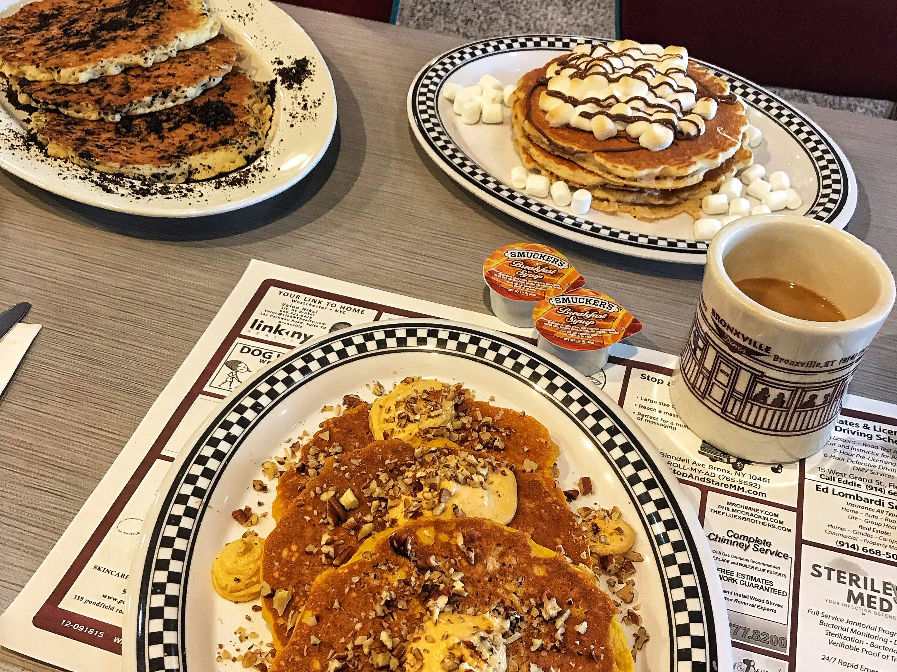 Lots of pancake options at the Bronxville Diner including, from left, the Oreo, the Triple Decker and the Pumpkin Pecan. Photographed Dec. 13, 2018.