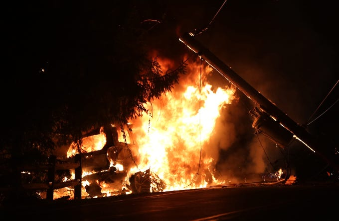 A Subaru Forester is fully engulfed in flames after it struck a utility pole on Milltown Road in the town of Southeast July 17, 2018. The driver was uninjured in the 4:30 AM crash. Putnam Lake firefighters responded and extinguished the fire.