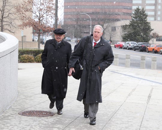Hector May, left, enters federal court in Whit Plains with attorney Kevin Conway, Thursday, Dec. 13, 2018.