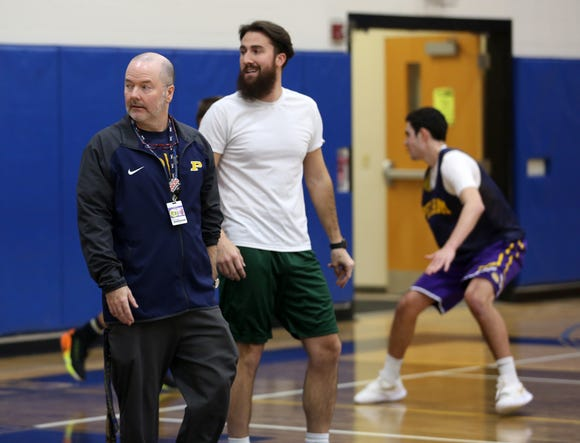 From right, Pelham basketball coach Mark Courtien along with assistant coach Mark Finegan run a drill during practice at Pelham High School Dec. 12, 2018. Finegan used to be the Pelham head coach, and Courtier was one of his players.