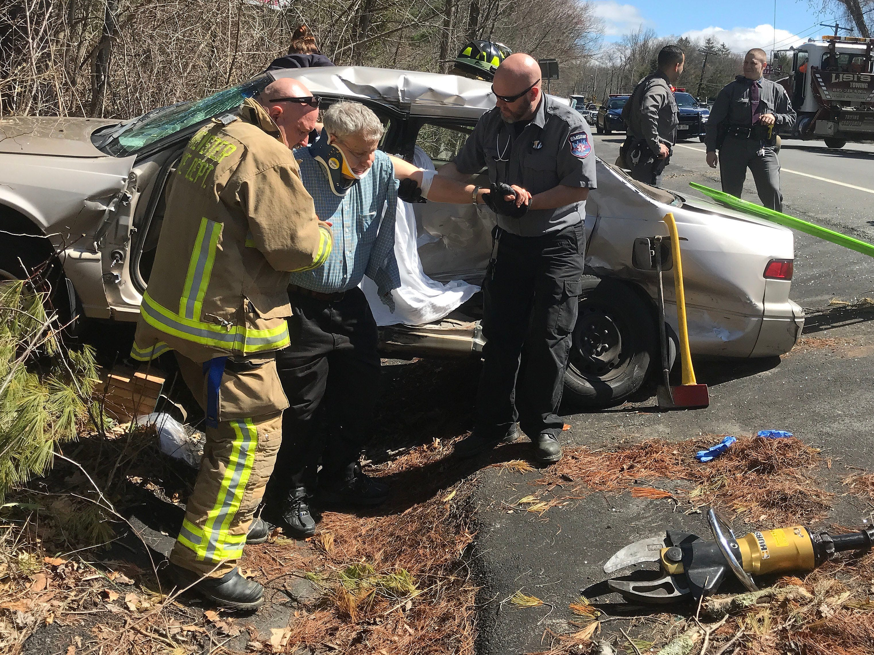 First responders aid an injured driver from his vehicle after it crashed into a van on Route 22 in Brewster April 26, 2018. Rescuers had to cut the door off the vehicle to remove the driver, who was transported to Putnam Hospital center in Carmel.
