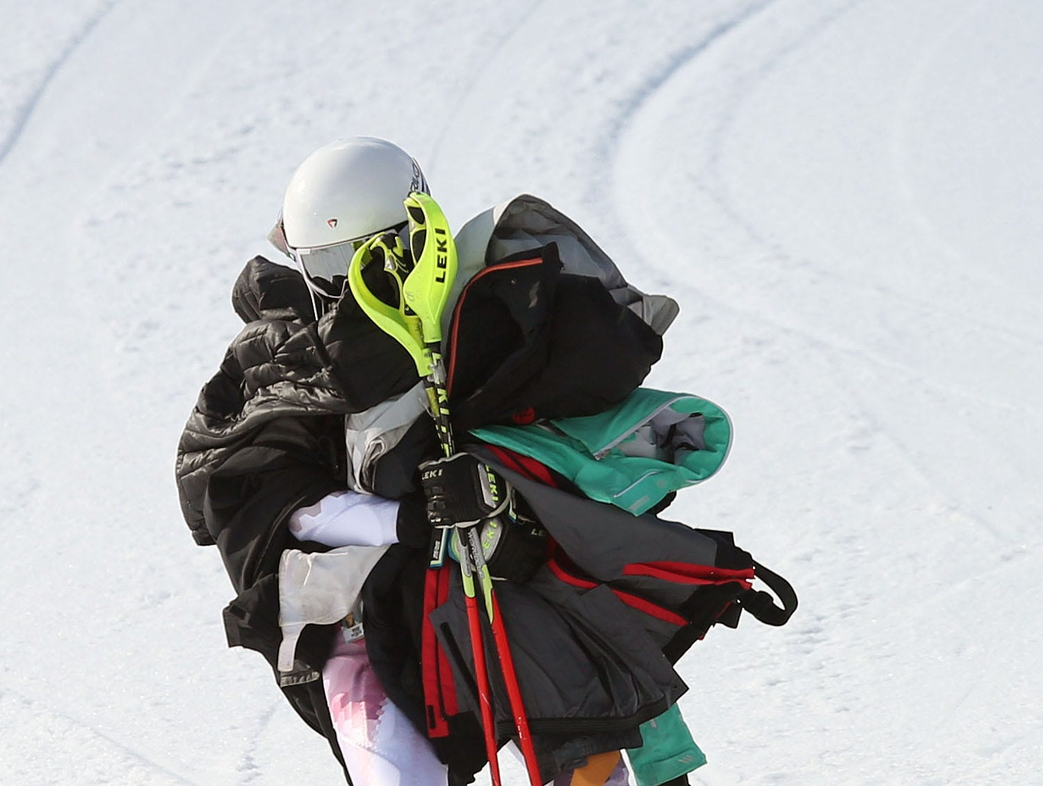 A ski team member brings his teammates jackets down the hill during the Section 1 skiing championships at Hunter Mountain Feb. 14, 2018.