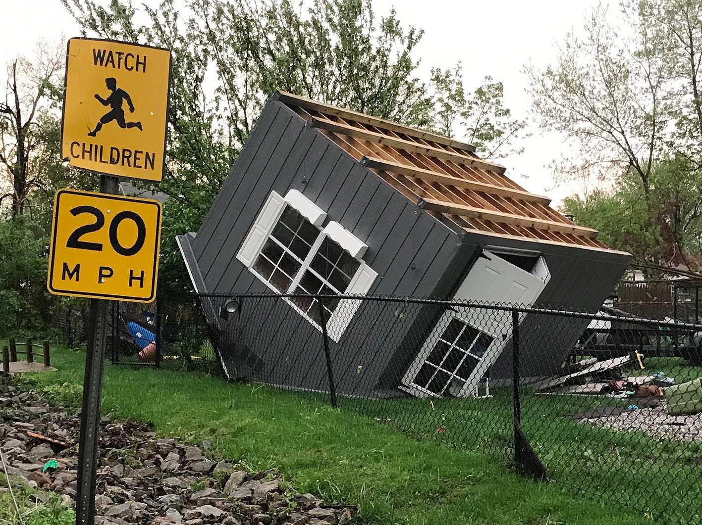The morning after an EF-2 tornado hit Lake Carmel, a child's playhouse was seen blown over on Lake Shore Drive May 15, 2018.