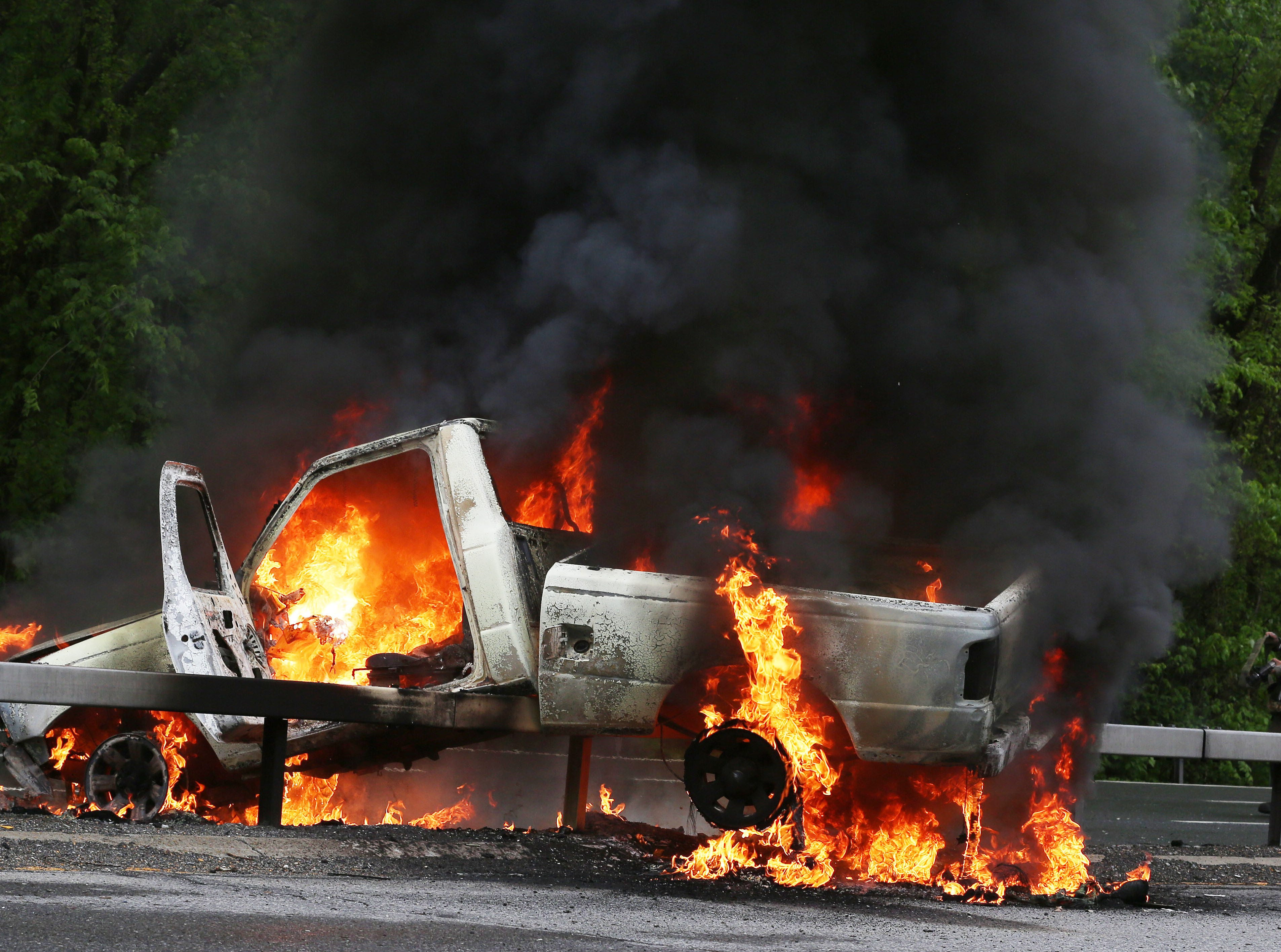 Katonah firefighters prepare to extinguish a fire in a pickup truck after it crashed into the center guardrail on the Saw Mill Parkway in Katonah Thursday afternoon May 17, 2018. The driver was not seriously injured.
