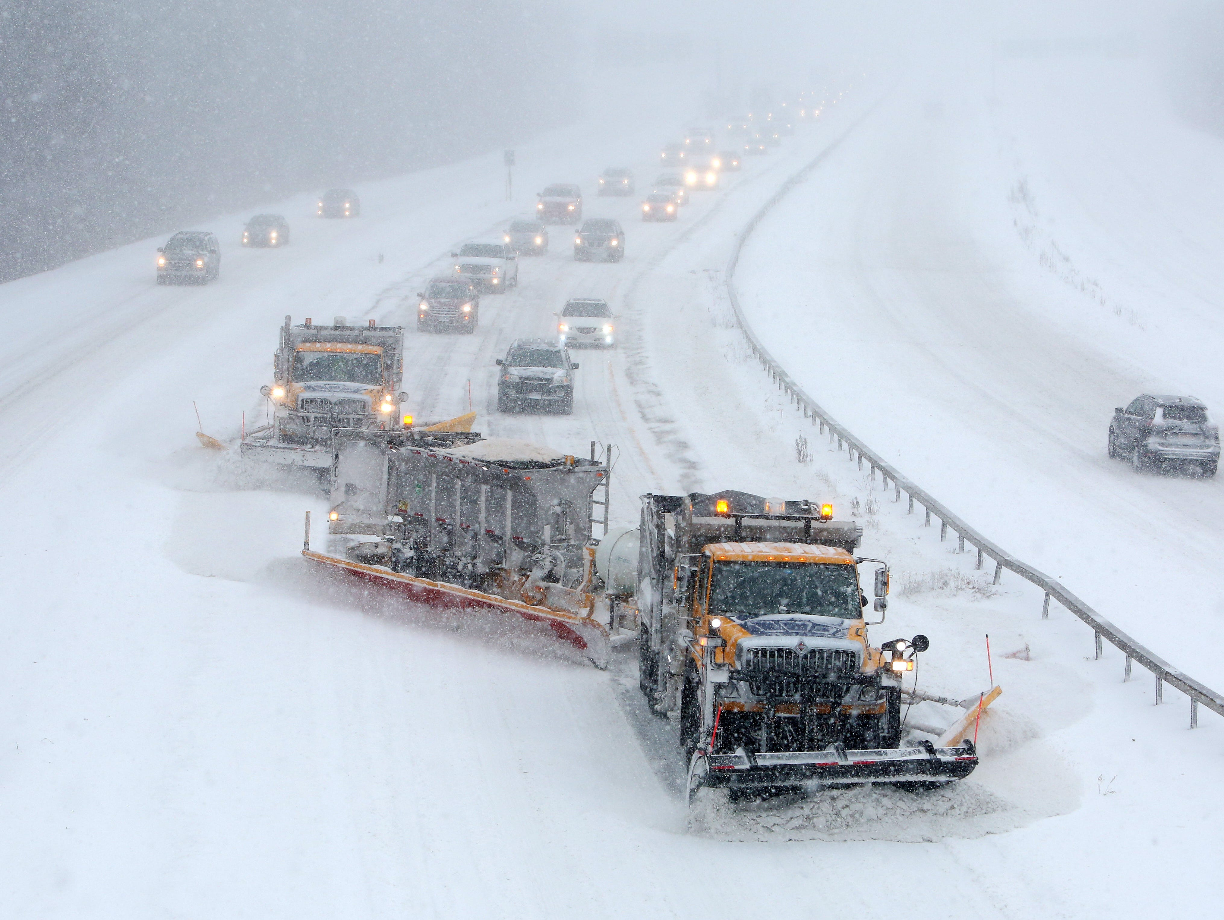Traffic northbound on Interstate 684 in Katonah follows a group of snowplows during a steady snowfall Jan. 4, 2018.