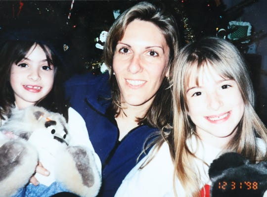 Diane Dinsmore, center with her daughters Kerri and Lauren, celebrated Christmas 1998 on New Year's Eve in their Washingtonville, New York, home because of Kerri's trip to Nyack Hospital. The 7-year-old was diagnosed with a brain hemorrhage and had seven hours of emergency surgery.