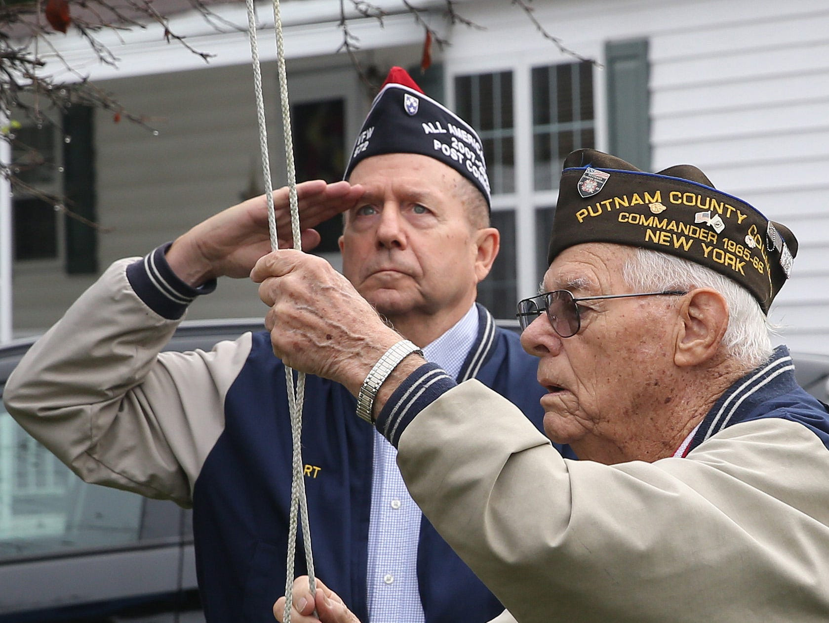 Art Hanley salutes as WWII veteran Tom Smith raises the American flag during at 9-11 remembrance at Sometime Retirement Community in Brewster Sept.  Sept. 11, 2018.