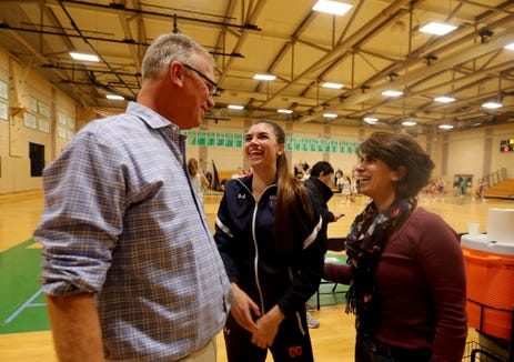Don Hamlin, coach of the Briarcliff High School varsity girls basketball team, laughs with his daughter Kacey, who plays on the team, and his wife Denise, who is the team's scorekeeper after Briarcliff defeated Irvington 52-43 at Irvington High School Dec. 12, 2018.