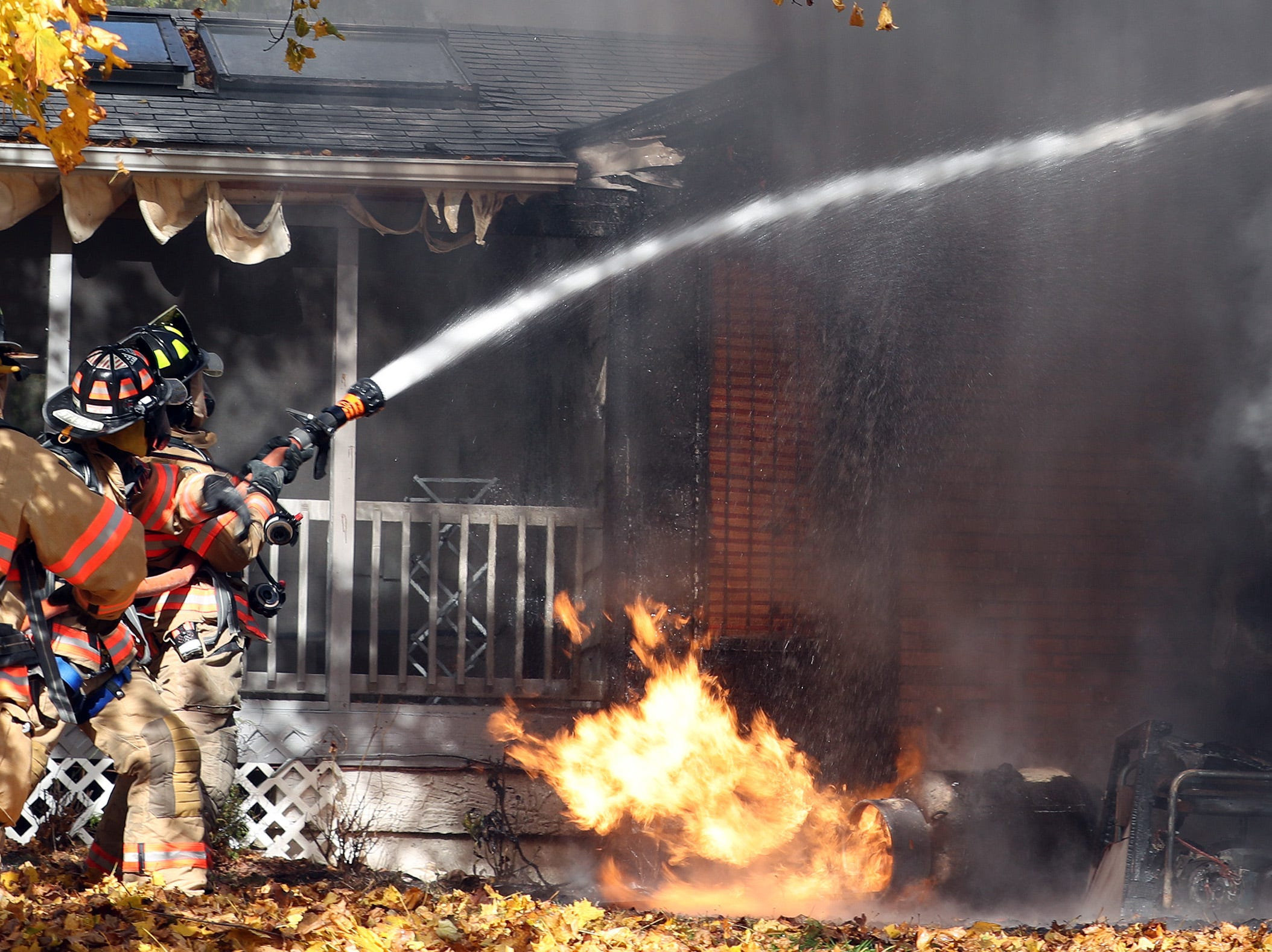 Mahopac firefighters attack a house fire that was fed by a burning propane tank on Lisa Drive in Mahopac Nov. 9, 2018.
