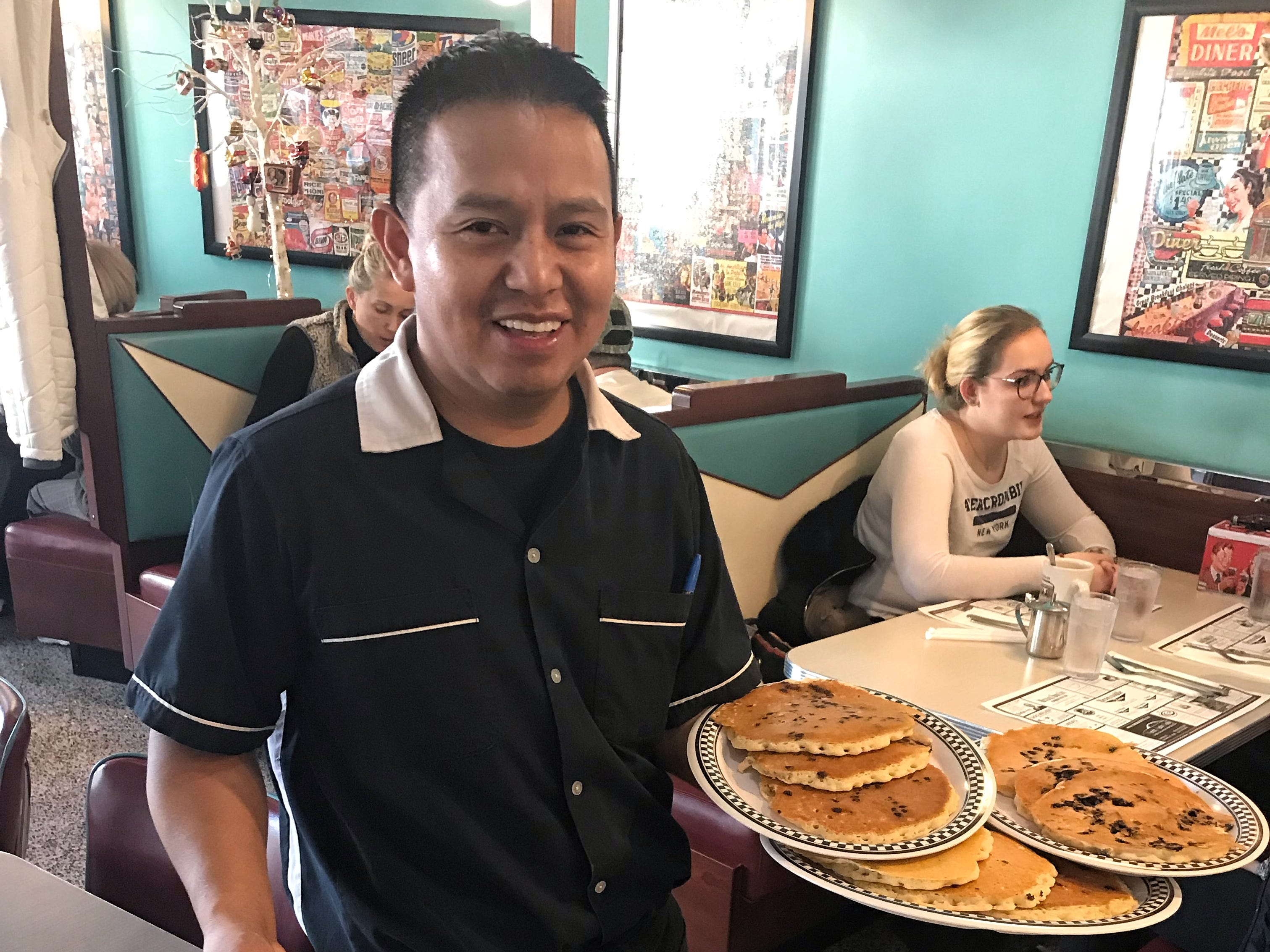 Otto Jimenez serves customers at Bronxville Diner in Bronxville. Photographed Dec. 12, 2018.