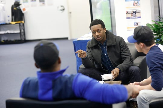 Brandon Michael Hall, 25, on the set for an episode of God Friended Me which is being filmed at A Game Sports in New Rochelle, speaks with fellow cast members on Dec. 13, 2018.