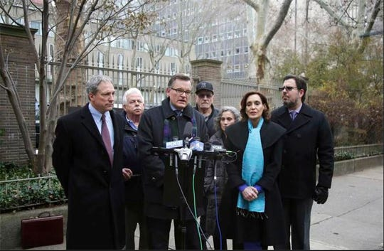 Attorney James Marsh and sexual assault victims and other attorneys hold a news conference in front of Rockefeller University Hospital in New York, Tuesday, Dec. 11, 2018. Former patients who say they were molested by a physician at the hospital, the late Dr. Reginald Archibald of Pelham, want to know what happened to photos that they say were taken while the abuse was occurring.