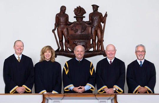 Supreme Court Justices Collins J. Seitz, Jr., Karen L. Valihura, Chief Justice Leo E. Strine, Jr., James T. Vaughn, Jr. and Gary F. Traynor