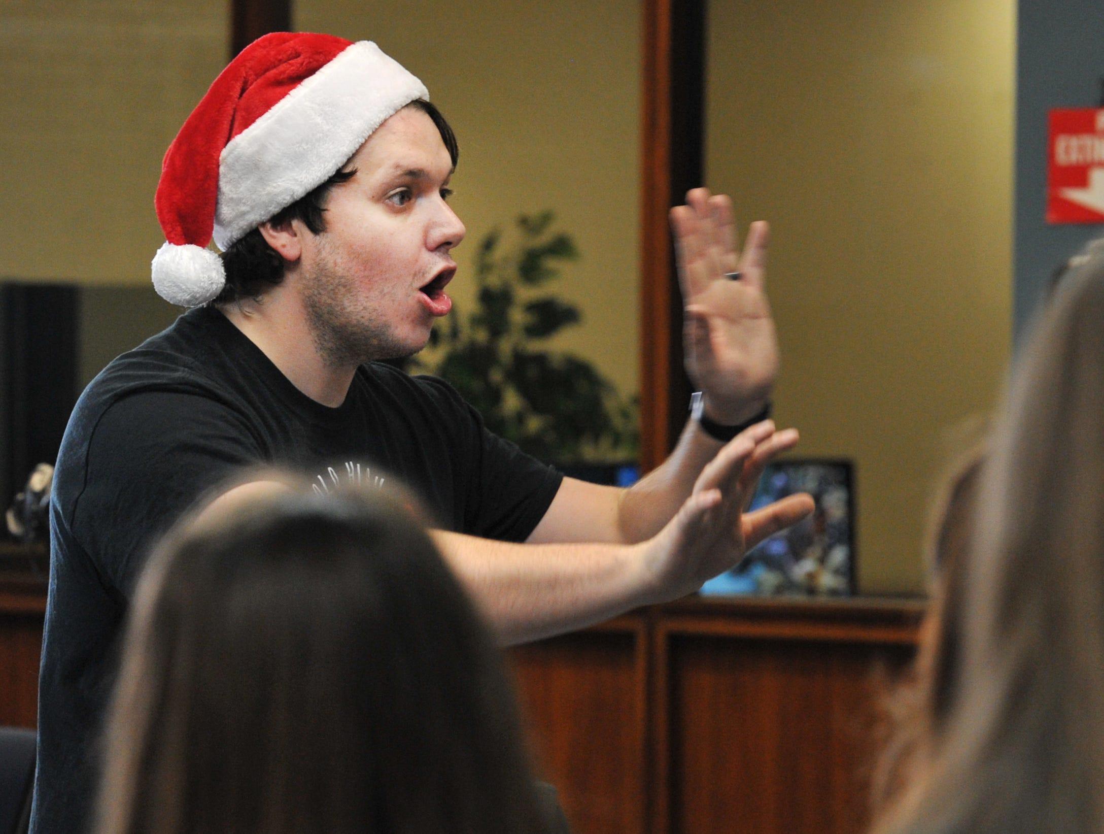 Wichita Falls High School choir director Chris Jarvis directed his choir class during the choir's annual caroling trip around Wichita Falls.