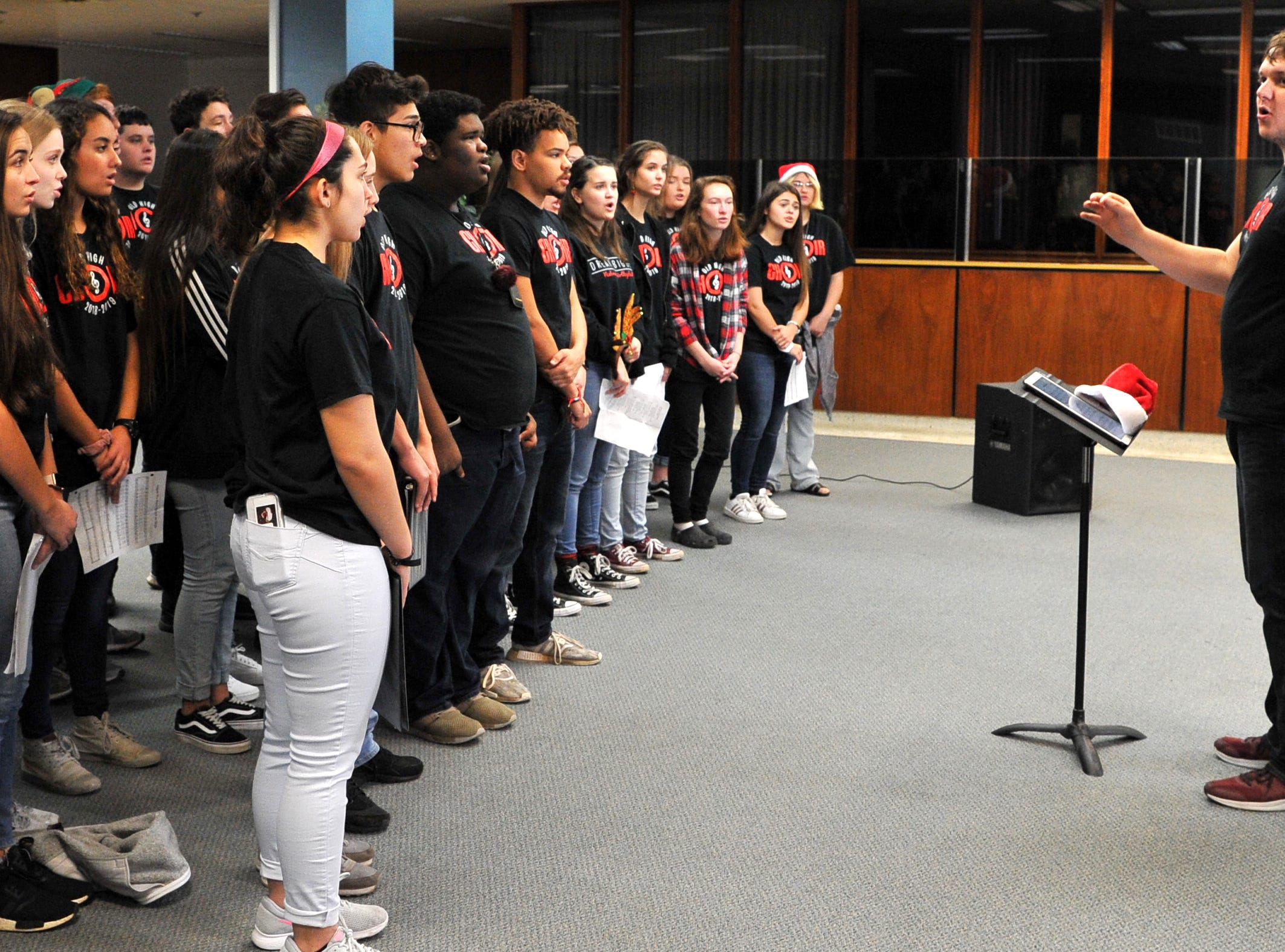 Students from the Wichita Falls High School choir made a stop in the Times Record News retail department to sing Christmas carols during their tour around town Thursday morning.