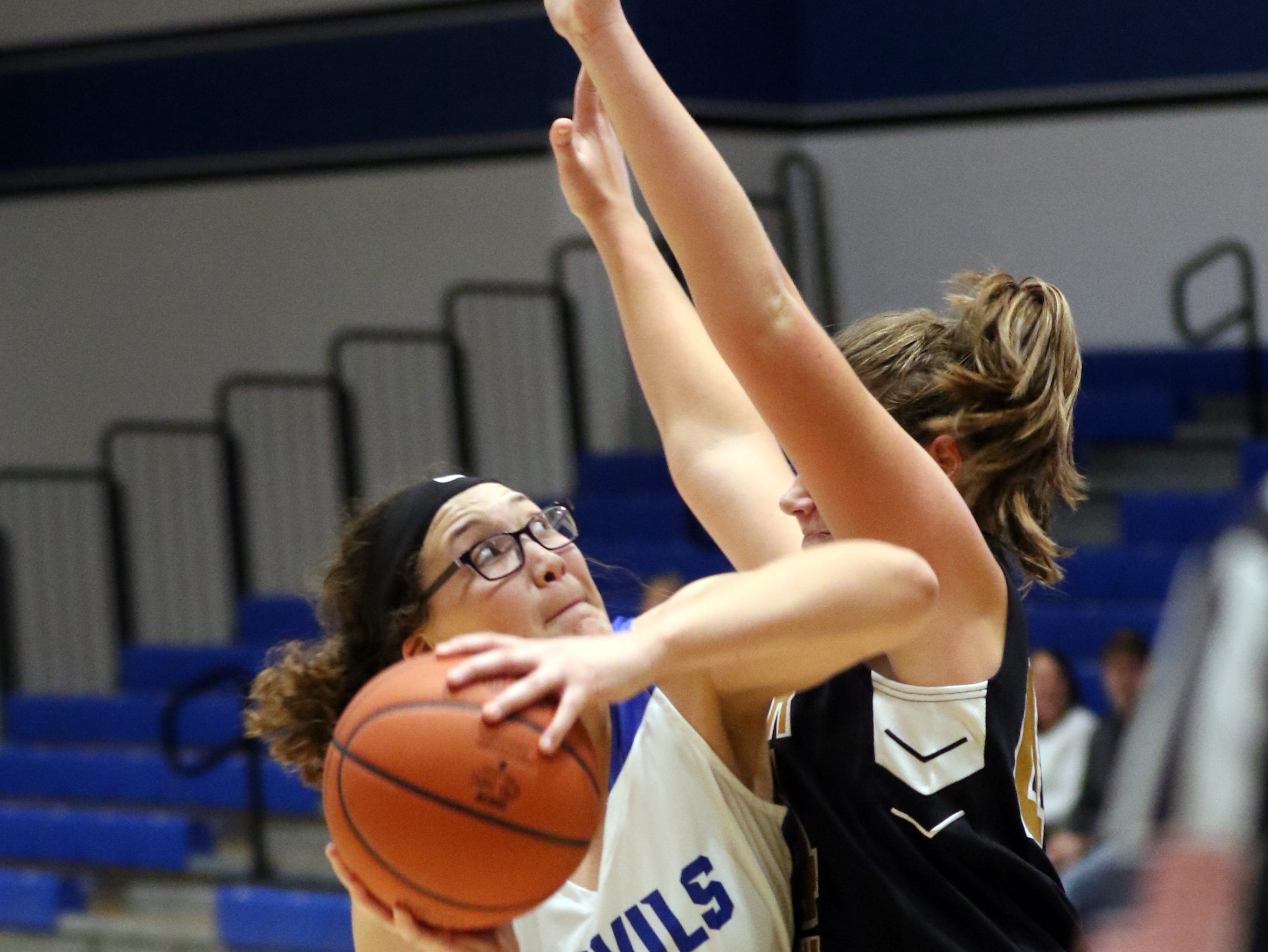 Zanesville's Alena Mayle drives to the hoop against River View.